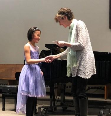 Victoria Lee receiving her scholarship as Junior piano award winner
