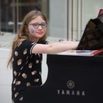 A young student preparing to play piano
