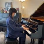 Yang playing piano in her teacher's studio
