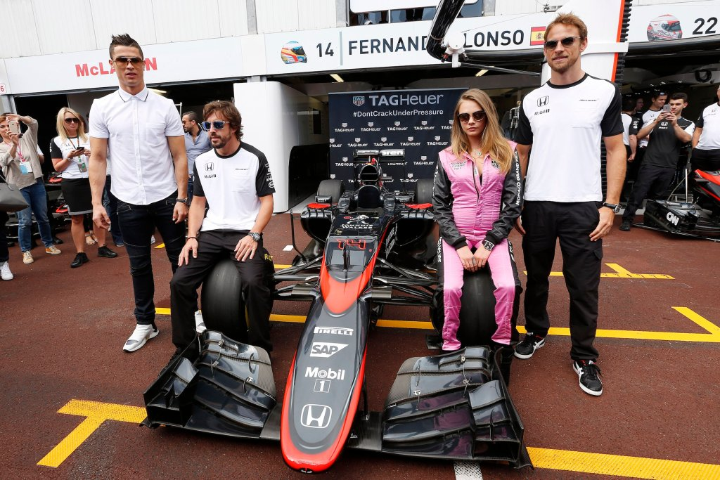 Monte Carlo, Monaco. Sunday 24 May 2015. Cristiano Ronaldo, Fernando Alonso, McLaren, Cara Delevigne and Jenson Button, McLaren, pose on the McLaren. World Copyright: Alastair Staley/LAT Photographic. ref: Digital Image _R6T1467