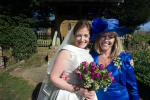 Image of mother and bride outside St Botolph's Church