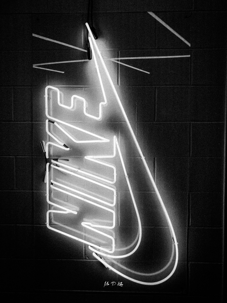 Black and white image of Nike logo in niketown chicago