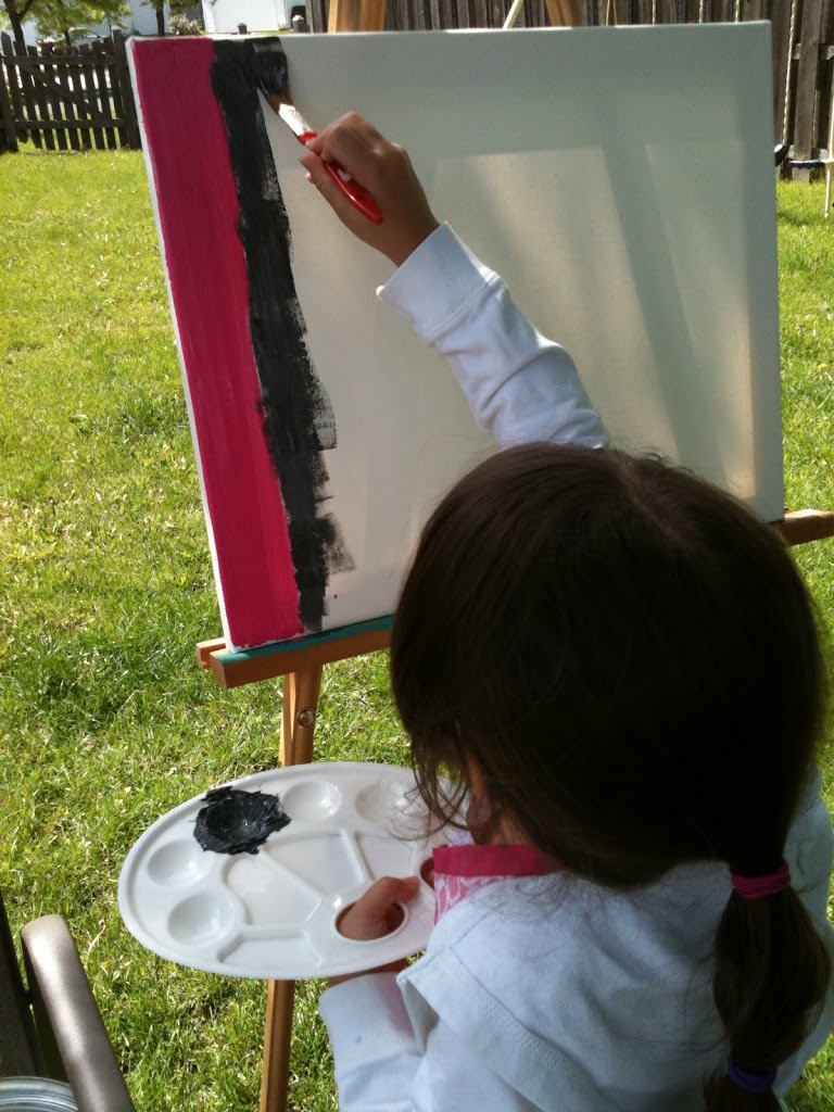 Baby girl painting the eiffel tower