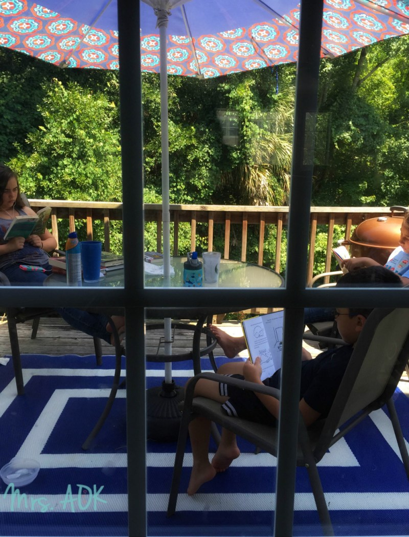 Kids and books on the deck