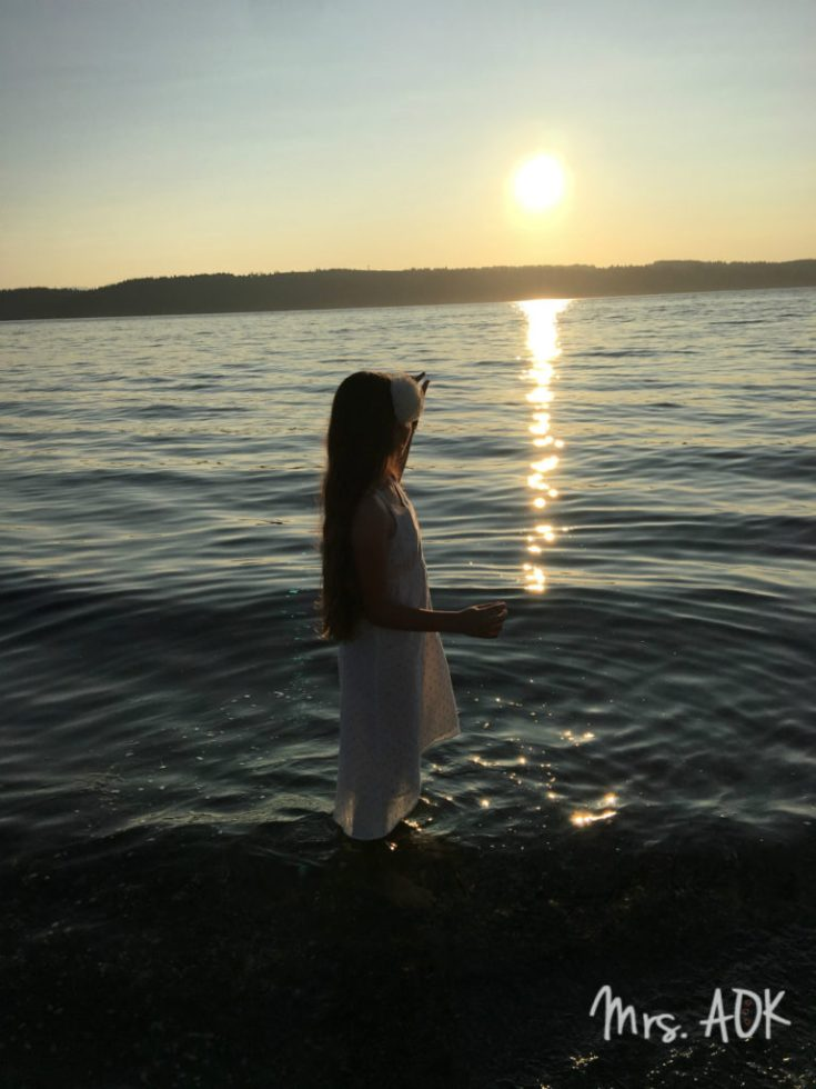 Baby girl and the sunset