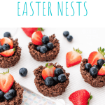 chocolate nests filled with fruit, on white background