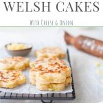 cheese welsh cakes on cooling rack with cheese and rolling pin in background