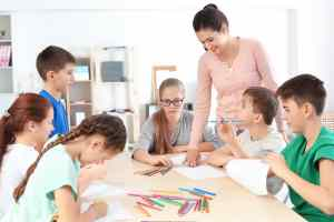 Female teacher conducting lesson in classroom