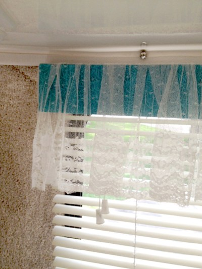 Up Close of White Lace Window Treatment Valance on Casita Travel Trailer