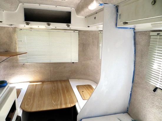 Chalk painted walls in a Casita Travel Trailer, and reinstalling doors.