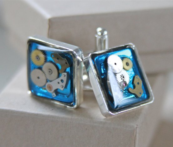 Animac Designs, Watch Part Cufflinks, Silver-plated cufflinks made with old watch parts. Each pair is unique and will differ slightly from the photo shown. The cufflinks come boxed in a recycled embossed box.
