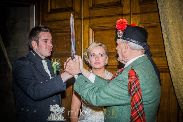 mike cook photography, bride and groom, piper, wedding cake, sword
