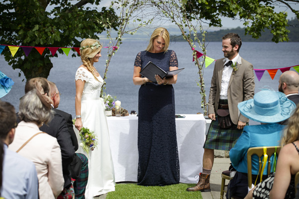 outdoor wedding ceremony, melanie leckie humanist, silver photography, bride and groom, colourful bunting arch