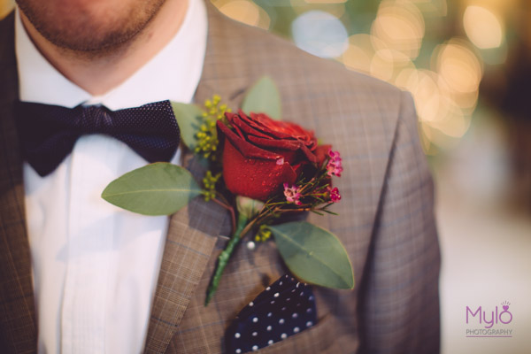 groom, red rose buttonhole, mylo photography