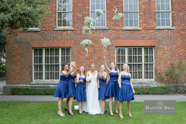 bride and bridesmaids, tossing bouquets, Winchester wedding photography, Martin Bell Photography,
