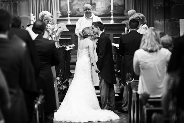 bride and groom kiss, wedding ceremony, david perkins wedding photography