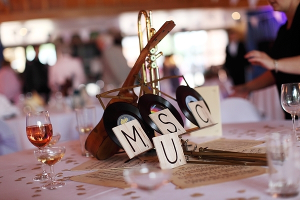musical wedding centrepiece, scrabble tyle, musical instrument, sheet music, david perkins wedding photography