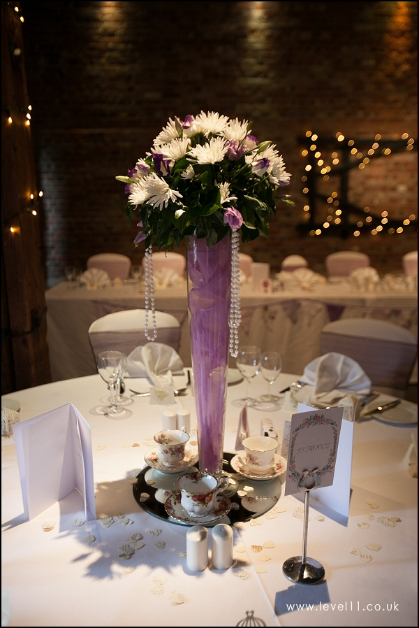 purple flower and pearl tall wedding centrepiece, level 11 photography