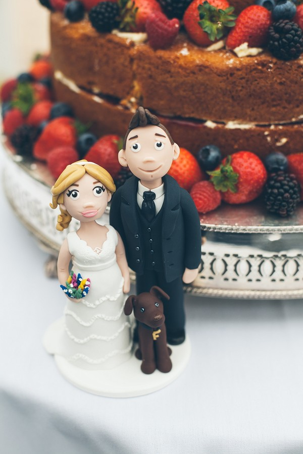 wedding couple and dog cake topper, that black and white cat, pets at weddings