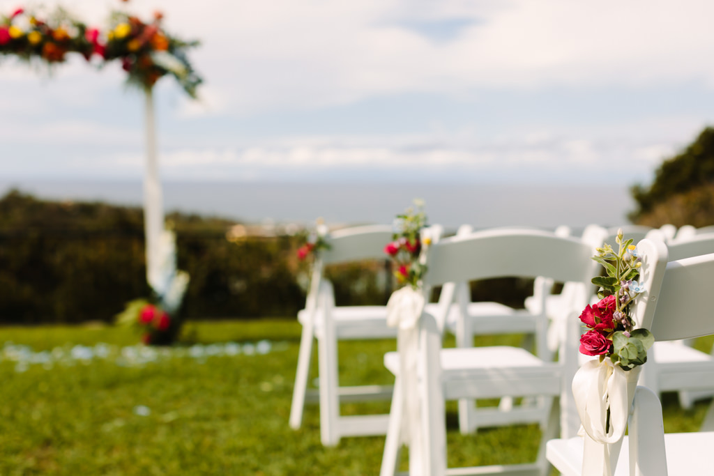 wedding arbour - white chairs with floral adornment - Tropical theme wedding - Gemma Clarke Photography