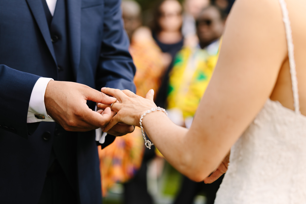 exchanging rings - Tropical theme wedding - Gemma Clarke Photography