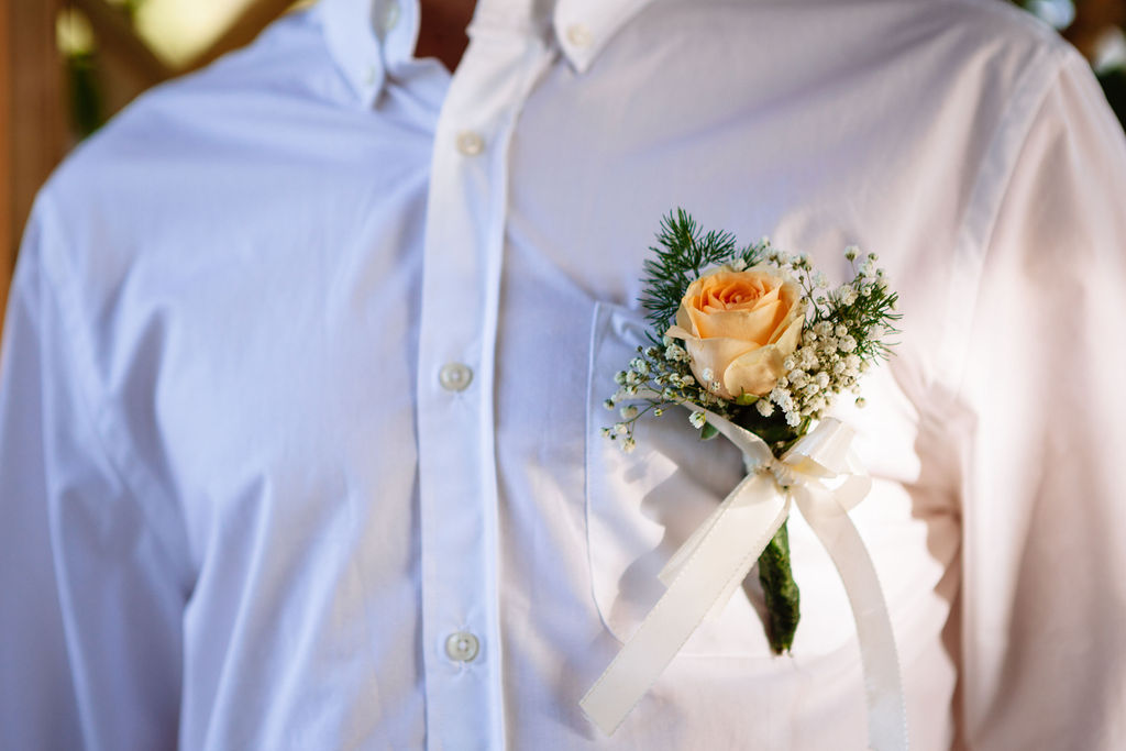 intimate wedding in Tuscany - Elizabeth Armitage Photography - peach floral buttonhole
