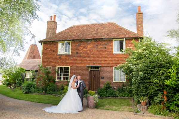 A stunning vintage inspired Kent Wedding at the Darling Buds of May Farm with pretty pink and purple detail
