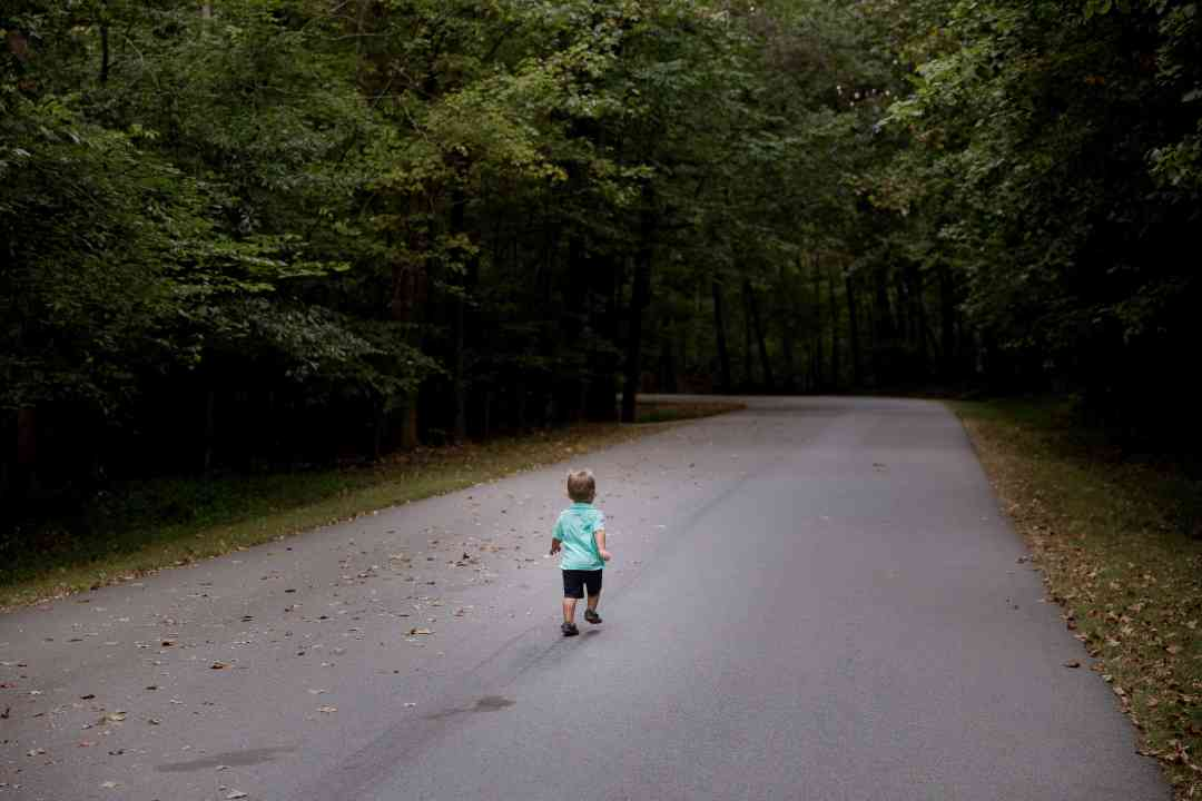 child in road