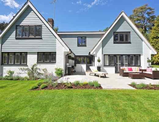 lawn New England home grey blue skies
