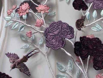 Silkwork embroidery onto power mesh - Reem Juan