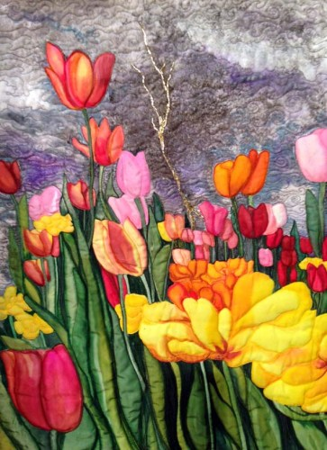 Spring Storm by Kathleen  Hughes uses decorative thread for drama, creating the lightning on this wall quilt.