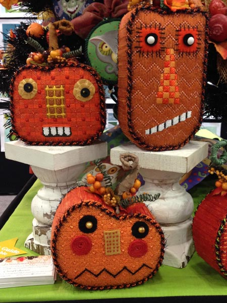 Needlepoint pumpkins get personality and pizazz through fabric and fibers, beads and buttons.