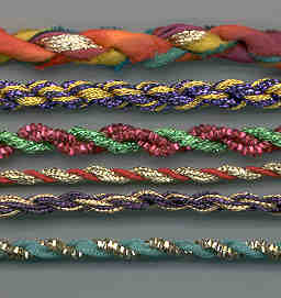 "Here are a few samples of fiber combinations: silk ribbon and Kreinik 1/8"" Ribbon in the top sample, for instance. You can combine many types of fibers, knitting yarns, Kreinik threads, ribbons, rickrack, etc."
