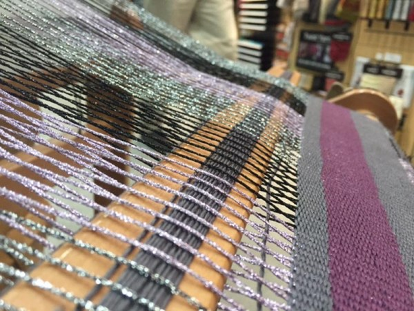 As with any fiber art, when you combine different types of yarn and thread, your finished project is more visually interesting. Use fiber, color and texture just like you would use spices and ingredients in a recipe. Kreinik Ombre is used in the warp here.