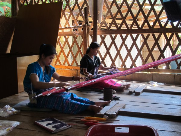 Women weaving at home.
