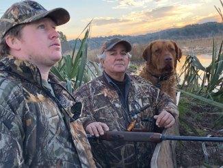 Singer/songwriter Zack Logan, Steve Chiasson and Sampson, a Chesapeake Bay retriever, on a duck hunt.