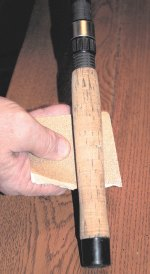 Very fine sandpaper removes the grime from cork grips.