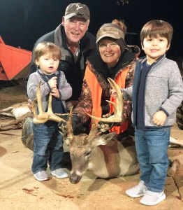 Augusta Smith celebrates her 165-inch buck with her husband Billy Key Smith and her grandsons.