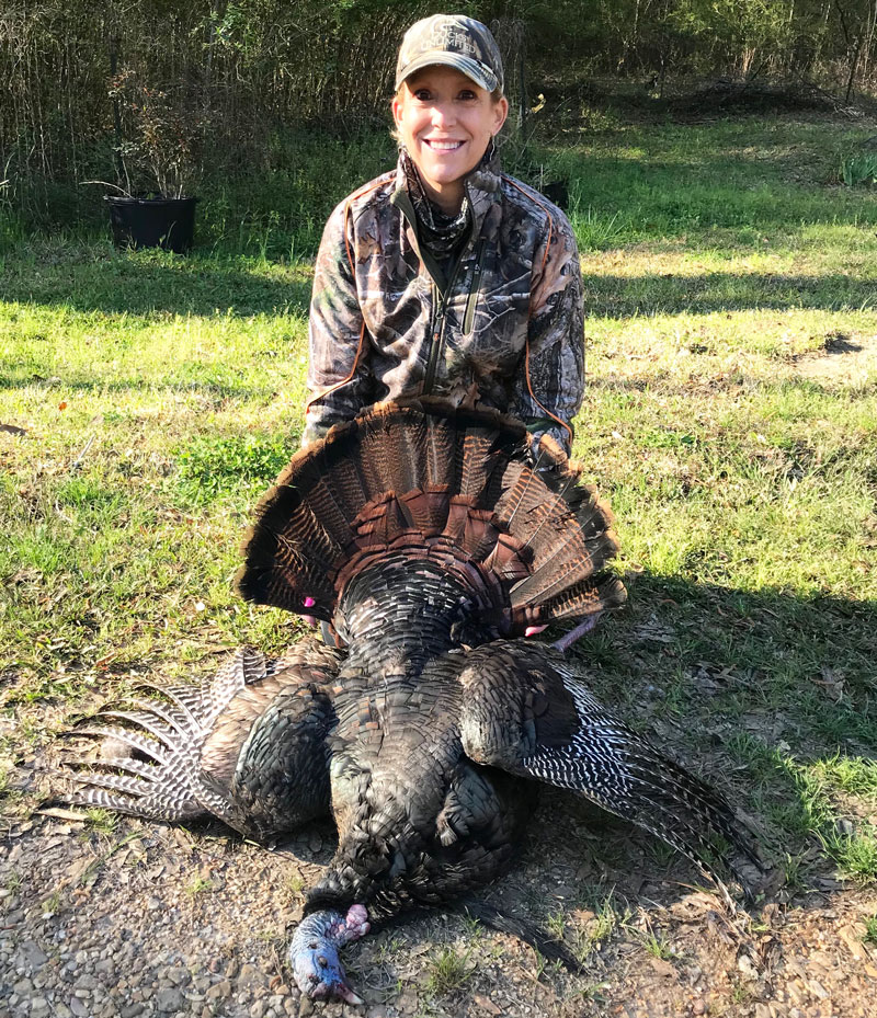 Sporting a thick 9-inch beard and 1 ¼-inch spurs, Lori Kennedy bags a nice gobbler on her first ever turkey hunt.