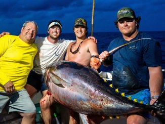 Mike McElroy III (far right) was on the rod when the crew of the Hook N Bull (from left, Mike McElroy II, Ryeley Jacobs and Luke Myers) landed a 236.6-pound yellowfin tuna out of Pass Christian, Miss., that appears to be a Mississippi state record. (Photo by John Michael Gory)
