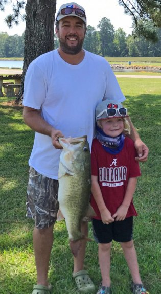 Trey Tanner and son Rhett caught a 10.1-pound, lake record bass last Sunday at Lake Tom Bailey.
