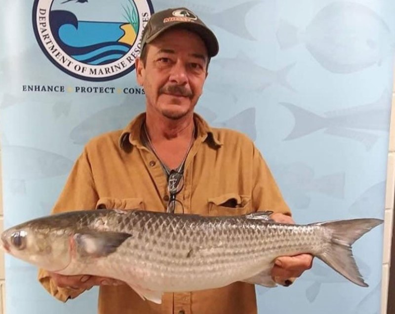 Joey Besancon Sr. with his new state record striped mullet. (Photo courtesy MDMR)