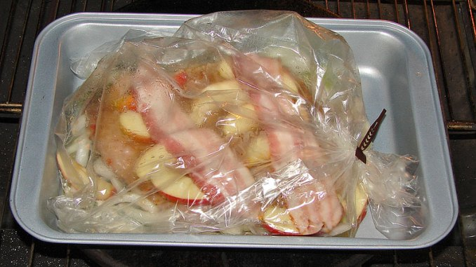 Wrapped up in all kinds of goodies — sliced applies, onions, bacon and asparagus, this wild turkey breast, in its new home in an oven bag, is ready for heat. (Photo by Jerry Dilsaver)