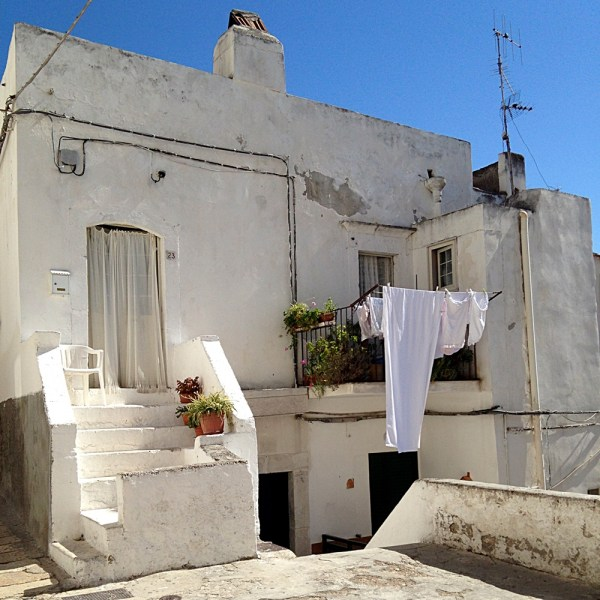 Clothes drying in Puglia, on Ms. Adventures in Italy by Sara Rosso
