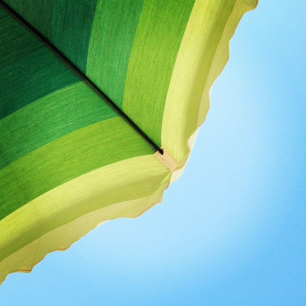 Colorful beach umbrella, Italy, on Ms. Adventures in Italy by Sara Rosso