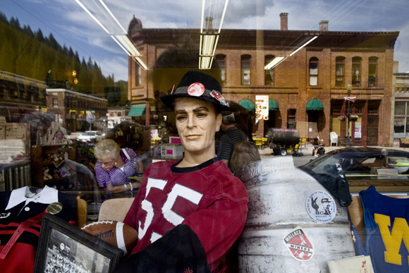 Highschool sports memorabilia fills a window display in Wallace, Idaho, USA.