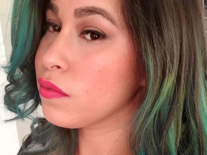 image of a woman wearing lipstick and green streaks in her hair