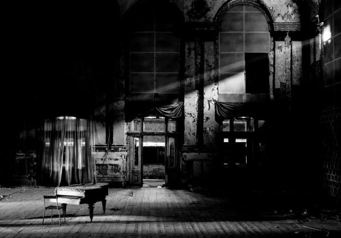 a black and white image of a piano