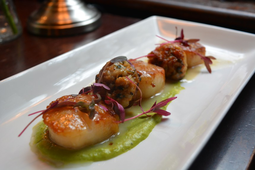 Seared king scallops with rabbit and sage meatballs
