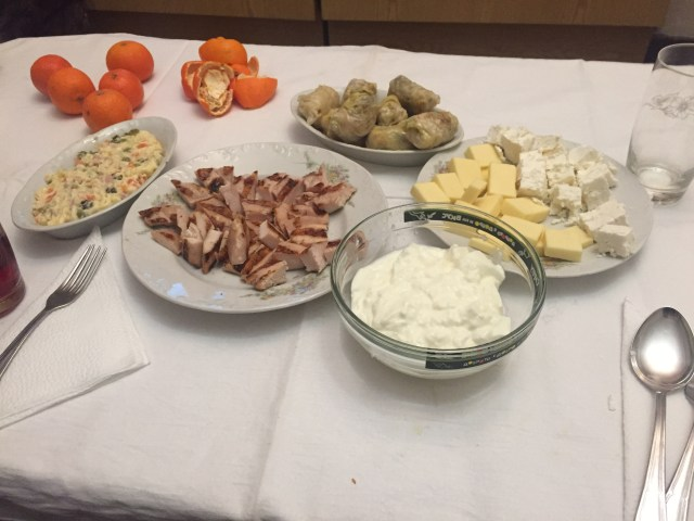 Bulgarian dinner with yogurt, cheese, bread, mandarin